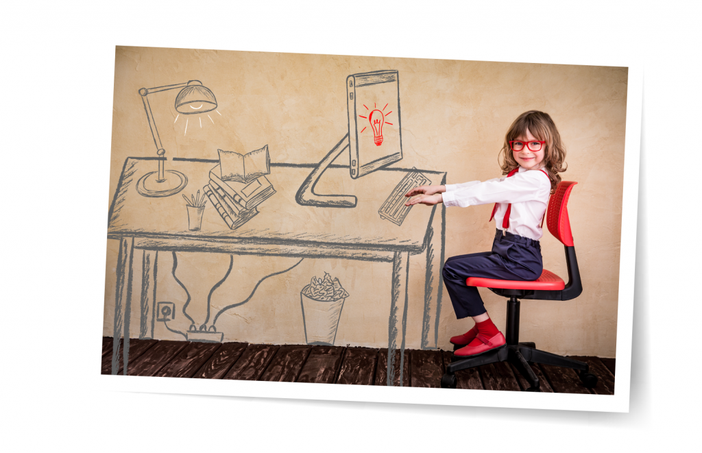 picture of a girl sitting at a drawing of a desk
